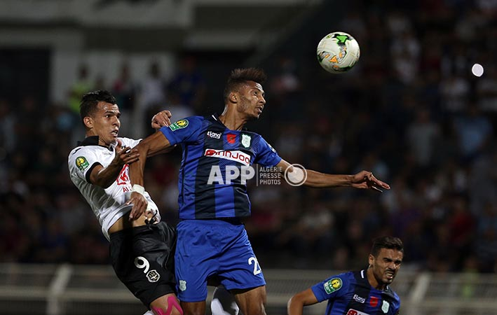 ES Setif player ELHABIB BOUGUELMOUNA  (L) and Difaa El Jadidi  player FABRICE GAEL NGAH (R) fight for the ball during the CAF Champions League soccer match between ES Setif of Algeria and Difaa El Jadidi  of Morocco at Stadium 8 May 1945 in Setif, Algeria, 17 July 2018