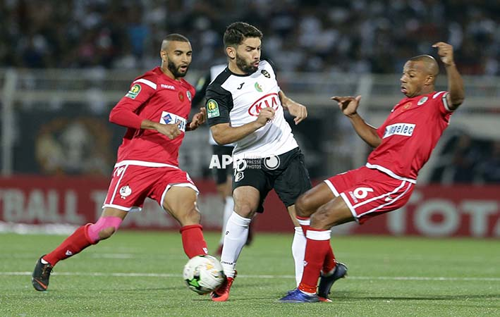 ES Setifienne player Abed el Moumen Djabou (L) and Wydad Athletic Club player Brahime nekache (R) fight for the ball during the African champions league Cup soccer match between ES Setifienne of Algeria and Wydad Athletic Club of Morocco at the 8 May 1945 Stadium, Setif 14 September 2018.