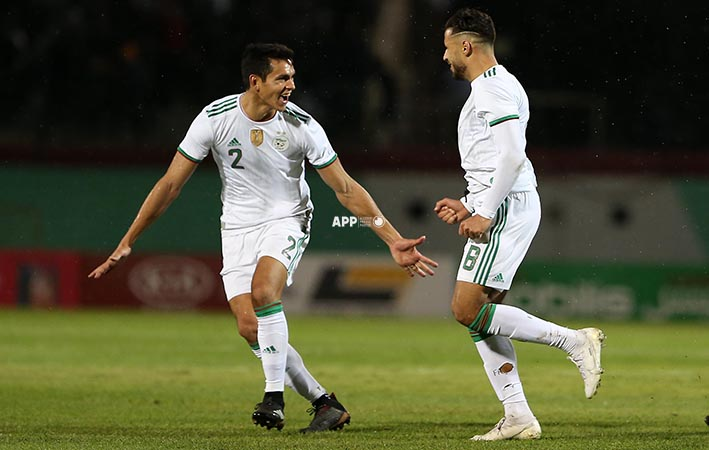 Algeria players Belaili youcef ( R) Mandi Aissa ( L) celebrate after scoring a goal during qualifications at the 2021 African Nations Cup of Nations soccer match at Mustapha Tchaker Stadium in Blida , Algeria 14 Novembre 2019.