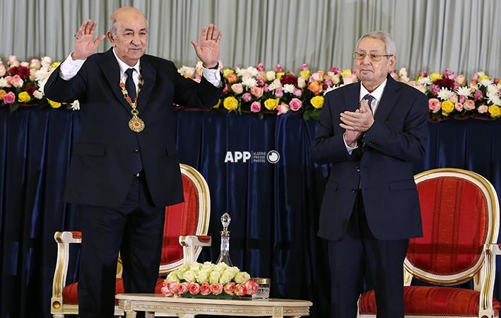 Algerian President-elect Abdelmadjid Tebboune (L) sits alongside interim president Abdelkader Bensalah during the formal swearing-in ceremony in the capital Algiers on December 19, 2019. - The 74-year-old Tebboune, a former prime minister seen as close to the country's powerful military chief, reportedly garnered 58.13 percent of votes in the first ballot of a highly contested presidential election, according to the announced final results. He said after his victory he was ready for dialogue with a months-long protest movement that toppled h